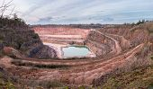 Wide Angle View Of Stoneycombe Quarry In Devon, England, Uk. Limestone Is Quarried From The Site And poster