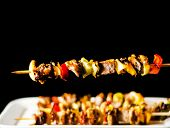 Grilled Skewers Of Meat And Vegetables On A Wooden Board, Colorful And Tasty Dish poster