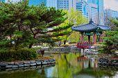 Yeouido Park public park pond with pavilion summerhouse in Seoul, Korea poster