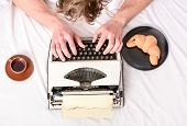 Old Typewriter On Bedclothes. Male Hands Type Story Or Report Using Vintage Typewriter Equipment. Wr poster
