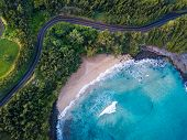 Aerial view of the sandy beach and curved asphalt road on the west coast of Maui. Hawaii poster