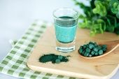 Close Up Vegan Blue Spirulina Smoothie And Spirulina Pills , Healthy Superfood Diet And Detox Nutrit poster