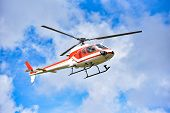 Helicopter Flying On Sky / White Red Fly Helicopter On Blue Sky With Clouds Good Air Bright Day  - H poster