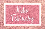 Hello February Greeting Card Message, White Text And Frame Against A Shiny Pink Glitter Background. poster