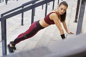 Fitness Sporty Woman Doing Push-ups Outdoor. Beautiful Fit Girl On Stairs. Fitness Model Outdoors. W poster