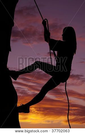 Woman Silhouette Climbing Rock