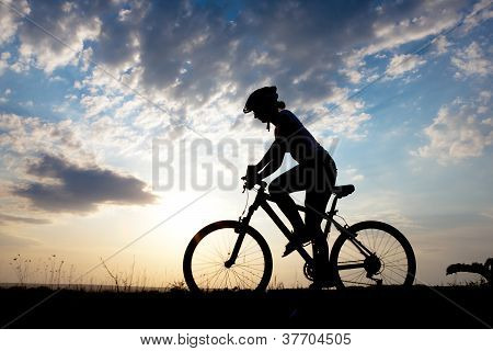 Biker-girl At The Sunset