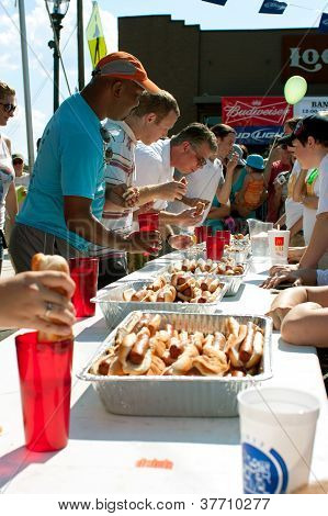Contestants Compete In Hot Dog Eating Contest