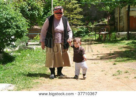 grandmother teaching walking