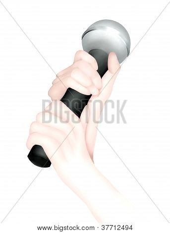 A Hand Holding Up A Microphone for Singing or Interview