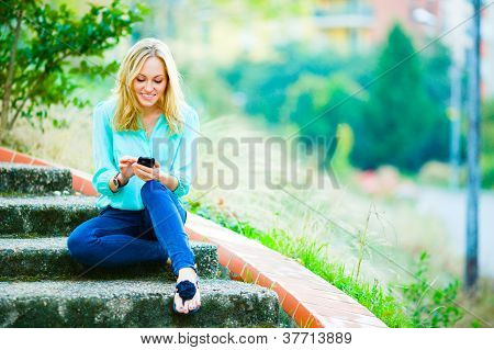 Happy smiling girl writing a message