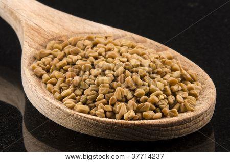 Fenugreek Seeds On A Kitchen Spoon