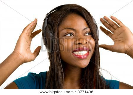 African American Lady Listening To Music With Headphones