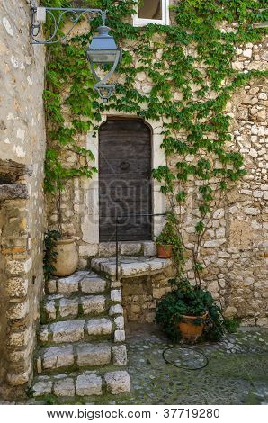 Old village doors with steps