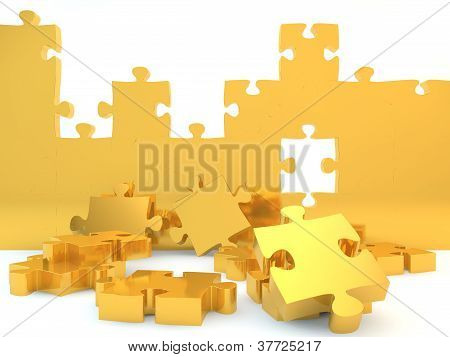 A partially completed gold jigsaw puzzle