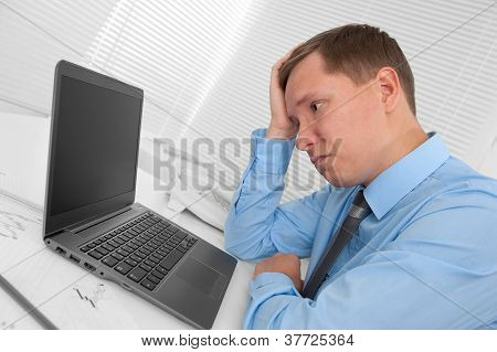 Businessman Having Stress In The Office