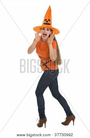 Young Woman In Halloween Shouting Through Megaphone Shaped Hands