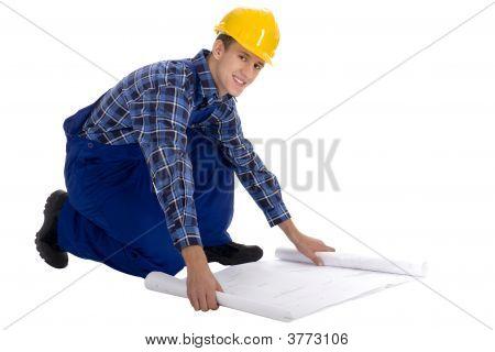 Obrero con planos