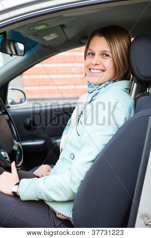 Cheerful Blond Female Driver In Car Vehicle
