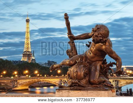 Eiffel Tower and Pont Alexandre III at night.