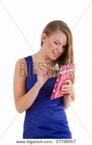 girl in a blue dress with long hair unleashes tape for Christmas gifts
