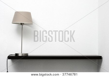 Shelf On The Wall With Lamp