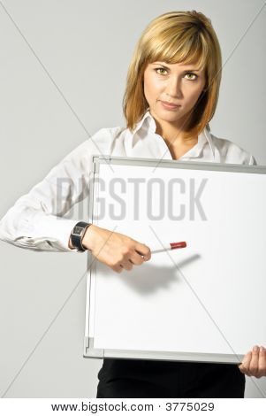 Business Lady Pointing To Whiteboard