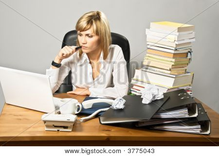 Thoughtful Business Lady At Desk