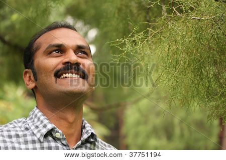 Close-up Photo Of Hopeful, Relaxed & Happy Asian/indian Man Looking Confidently Ahead. The Executive