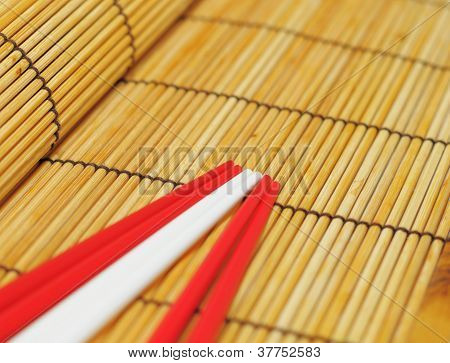 Bamboo rolling mat and different chopsticks