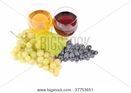 Green And Blue Grapes With Leaf And Wine In The Glass