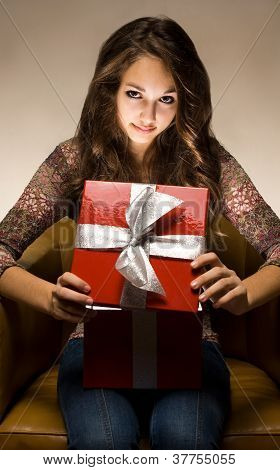 Beautiful Brunette Peeking Inside Gift Box.