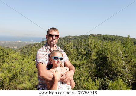 Father With Daughter On Valley Background