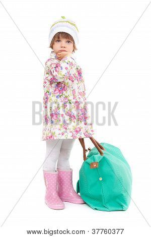 Pretty Little Girl In Autumn Clothes With A Big Bag. Studio Portrait Of A Full-length.
