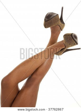 Woman Gold Shoes Crossed Up