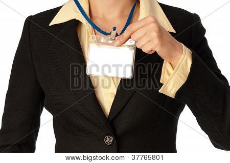woman showing her badge
