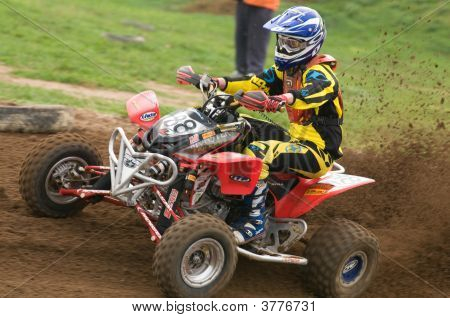 Atv Motocross Rider Powering Out Of Corner