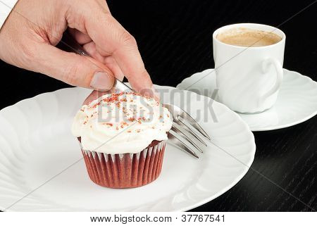 Picking Up Fork To Eat Red Velvet Cupcake With Espresso