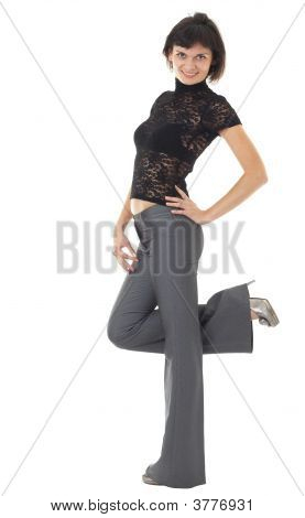 Young Woman Standing Against White Background..