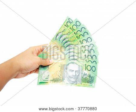 Woman hand holding a heaps of Australian money