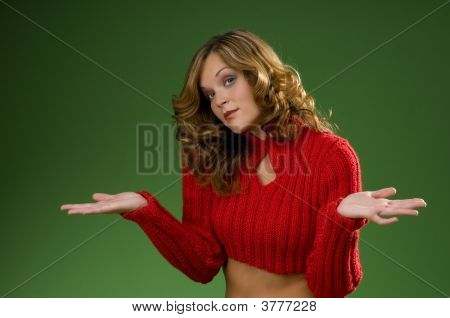 Indecisive Woman On Christmas Green Background