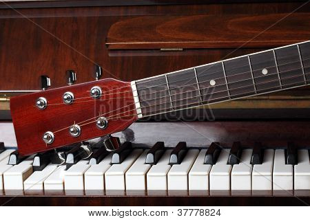 Guitar Neck On Old Piano Keys