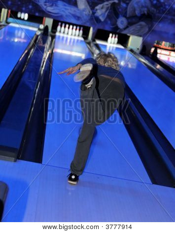 Girl Bowling In A Blue Light Designed Venue