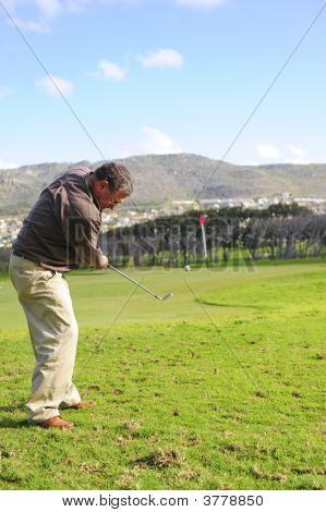 Senior Golfer In Action