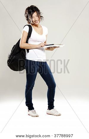 Young Asian Student Holding Textbooks
