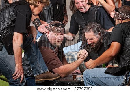 Man Winning Arm Wrestling Match