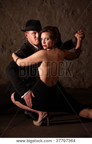 Tango Dancer Holding His Partner