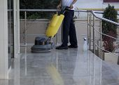 foto of cleanliness  - cleaner is cleaning floor with a machine - JPG