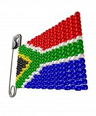 picture of zulu  - A safety pin with a traditional zulu beaded brooch depicting the south african flag on an isolated background - JPG