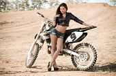 Sexy beautiful girl in fashion clothes with motorbike